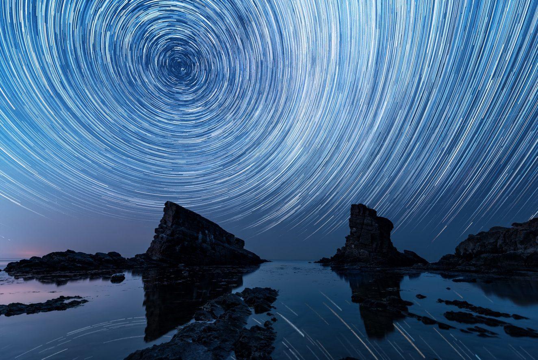 Star trails over the rock phenomenon The Ships (Bulgaria)
